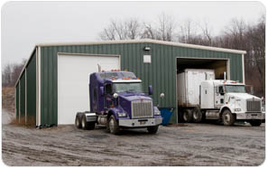 Green Metal Buildings For Truck Storage pictured