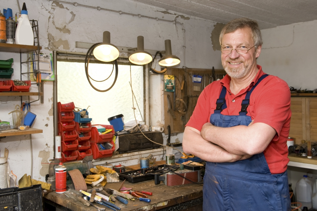 man standing with his finished workbench