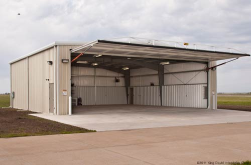 Steel farm buildings metal pole barns olympia buildings for Pole barn equipment shed