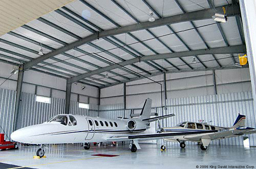 https://www.olympiabuildings.com/wp-content/uploads/2015/04/private-jet-hangar.jpg